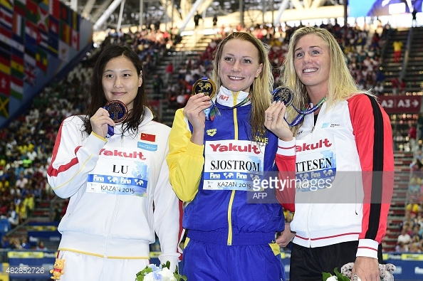 Not sure if the 50m butterfly podium or the 100m butterfly podium... Also notice the melancholic look by Ottesen!