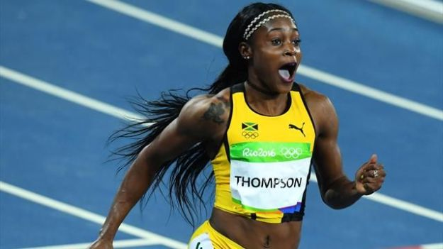 I looove Elaine Thompson, I really do. But what's with that neck bracelet thing? I remember a time when all the girls used to wear that. That time was 2000...