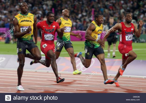 "Photographer: """"Stay out of focus if you ran faster than 10 seconds more than 60 times"" Asafa: :-)"